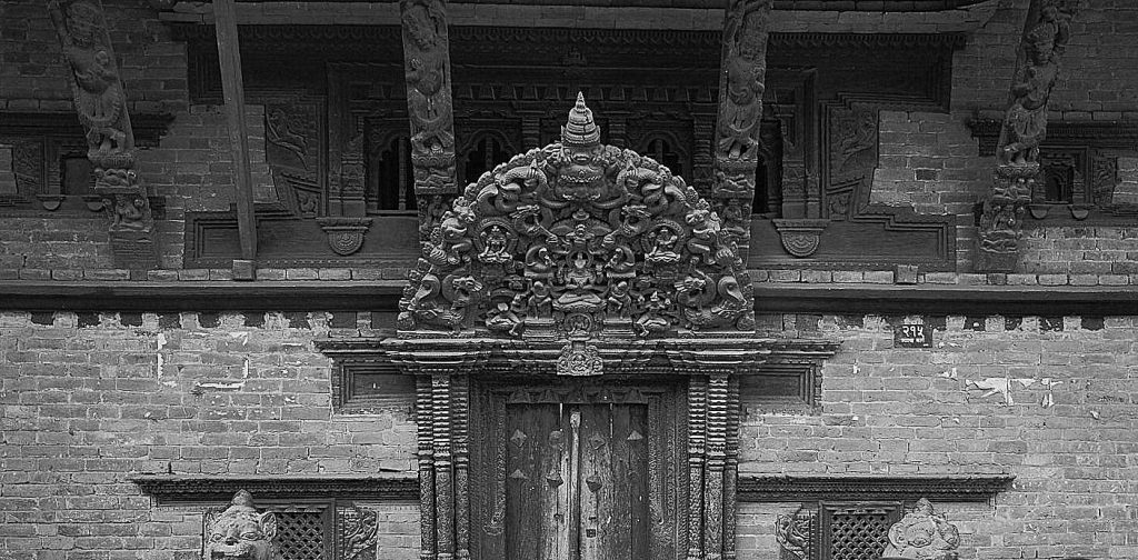 Doorway, Kathmandu. By Greg Willis from Denver, CO, USA - Chusya Baha, CC BY-SA 2.0, https://commons.wikimedia.org/w/index.php?curid=24310054